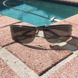 Gucci sunglasses chromish like sides black lens
